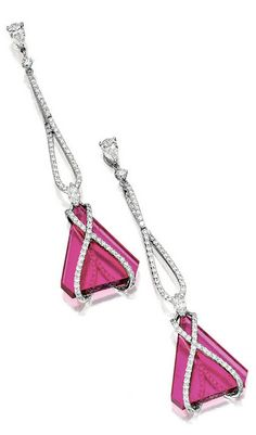*PAIR OF RUBELLITE AND DIAMOND PENDENT EARRINGS. Each suspending a cut-cornered triangular rubellite plaque, embraced by stylised ribbons pavé-set with brilliant-cut diamonds extending to the surmount, decorated by marquise- and pear-shaped diamonds, the rubellites and diamonds altogether weighing approximately 19.85 and 2.10 carats respectively, mounted in 18 karat white gold.