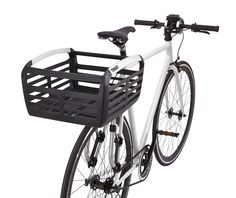 This stylish, convenient bike basket is made of durable polypropylene and aluminum. Sleek and lightweight, it's made to carry up to 2 grocery bags safely on the deck or rails of your front- or rear-mounted bike rack. Black with silver accents. http://www.etrailer.com/Bike-Accessories/Thule/TH100050.html