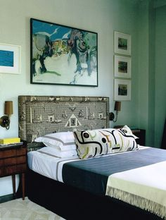 I love the painting, and the big tribal pillow on the bed in this room by Nick Olsen.  On the other hand, the upholstered headboard doesn't quite do it for me. Maybe it is simply too masculine, but it feels cowboy to me, despite the subject matter.