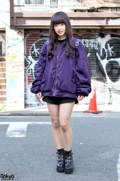 Riong is an 18-year-old apparel industry worker who we met on the street in Harajuku.  Her look includes a purple Fig & Viper bomber jacket over a Bubbles Harajuku top, Fig & Viper shorts, a purple transparent backpack from WEGO, and Bubbles Harajuku ankle boots.