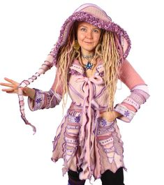 This pleasingly precious pastiche is a poem of powdery pink with pinwheels of purple and paisley playfulness. Its a wrap style that closes with two ties and features a hand-knit nubbly lilac brim.  Bust: 37 Length: 37  Size: MEDIUM SMALL  For reference the model is 510 size 12, 36D.  Enjoy!