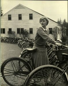 At the bike rack in front of Navy House (now the Wellesley College Club), 1949