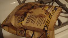 Use A Popcorn Bag's Vent to Filter Out Kernels