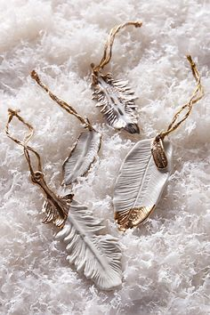 gold flecked feather ornament #anthrofave #christmasdecor