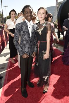 """Caleb McLaughlin and Millie Bobby Brown of """"Stranger Things"""". Emmy Awards 2016. Emmys 2016. Red Carpet."""