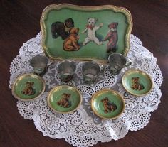 This tin lithograph tea set is so sweet. A tray with four matching cups and saucers. The teddy bear theme should do well with the Teddy Coll...