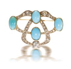A Fabergé jewelled gold brooch of overlapping double oval openwork form, set with diamonds and four turquoise, by workmaster Oskar Pihl, Moscow, circa 1895.