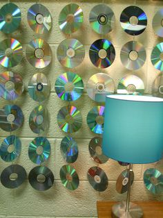 Drilled holes into CD's and used paperclips to string them together to make a wall hanging for my classroom.  (great for a rec room or play room!)