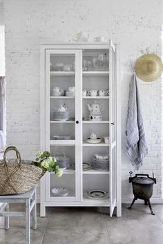 Scandinavian Cottage Decor With Rustic Touches - DigsDigs Houses In Poland, Scandinavian Cottage, Scandinavian Style, Scandinavian Interiors, Rustic Staircase, Kitchen Decor, Kitchen Design, Bookcase With Glass Doors, Little White House