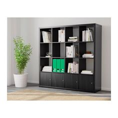 To show storage for family room KALLAX Shelf unit with 4 inserts - black-brown - IKEA