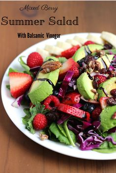 A sweet, spicy and tangy mixed berry salad with raspberries, strawberries, blueberries, avocado, red cabbage, black pepper pecans and a balsamic vinegar dressing.