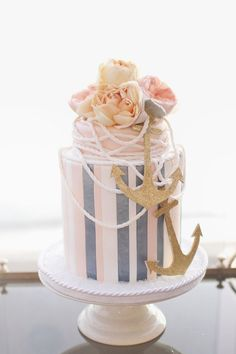 Stripes and Pearls for a Chic Nautical Wedding Cake | Green Tree Photography on @knotsvilla