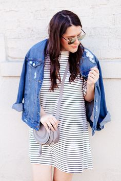 black and white striped dress with denim jacket and adidas superstars
