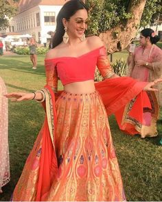 Orange is one colour which looks good on all Indian skin tones. If you too are looking to opt for an orange lehenga for your wedding or pre-wedding functions, then here are some ah-mazing ones. Indian Lehenga, Indian Gowns, Indian Attire, Indian Wear, Lehenga Choli, Bridal Lehenga, Brocade Lehenga, Pakistani Bridal, Manish Malhotra Lehenga