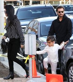 Happy family: The duo were joined by Kourtney's ex Scott Disick amid reports they are working on their relationship