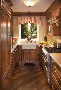 This small kitchen has a complete array of gourmet appliances with plenty of countertop for food prep. The wood flooring is set on a diagonal to make the space seem larger. In: Detail Design Colleen Moscone - Milford, MI Wood Flooring, Floors, Detail Design, Custom Kitchens, Food Prep, Countertops, Designer, Larger, Kitchen Ideas