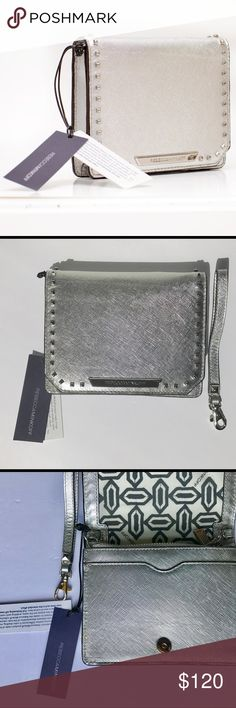 Rebecca Minkoff Shea Tech Crossbody bag in Silver Genuine Saffiano foiled Leather, Silver Studs and Silver Detachable Strap, fully lined with snap closure , interior zip pocket .  The bag is unused and doesnt have any defects . Bought it full price never ended using it selling it now because it doesn't fit my new phone. All photos are of the original bag i am selling . Rebecca Minkoff Bags Crossbody Bags