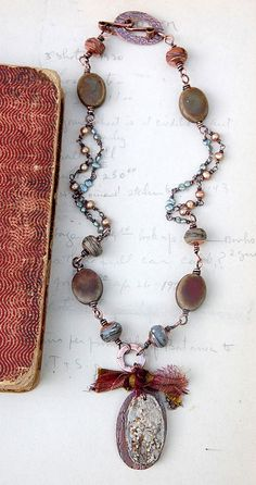 """""""Willow and Wisp"""" by Cindy Wimmer. Wire wrapped copper with pearls, ceramic beads, and focal by Humblebeads."""