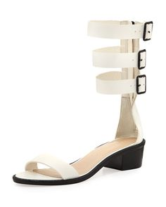 Patent leather Maude sandal with open toe.Strap on vamp Loeffler Randall logo on heel.Gladiatorstyle triple leather straps black hardware.Padded leather insole leather lining and outsole.1 12 heel.Made in Brazil. #Fashion  #NeimanMarcus