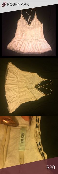 White lace and strappy tank top M Beautiful off-white colored lace tank top, from Urban Outfitters brand Kimchi Blue. Back has really pretty strap detailing. The bottom changes from lace to soft ruffling. So pretty but a little too big for me! Urban Outfitters Tops Blouses