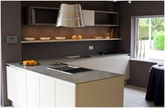 This kitchen is from the SL101 range by SieMatic. The cabinets are finished in Greige Matt and Titan Walnut laminates and the worktop is 1cm reinforced Hintertiessen granite.     There is ample storage, including a magic corner and all drawers have soft close mechanisms. Also included in the sale is a wealth of top of the range Gaggenau appliances. in excess of £40000