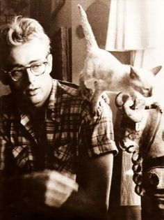 James Dean and his cat Marcus. 1955. Never though anything of James Dean before, but give him glasses and a cat, and I see what all the fuss was about