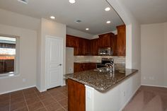 Concept 1606 Model at 2068 Leonard Ranch Road, tumbled marble back splash, brown cabinets, light granite