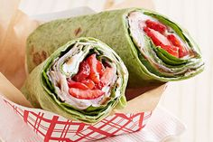 Savory and sweet all in one sandwich? Filled with cream cheese, spinach and sliced strawberries, this turkey wrap's got it all going on.
