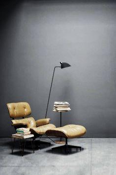 Chair, books, lamp.