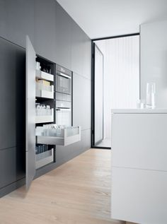 Larder units should have close stacked internal pull-outs with gallery systems and dividers – you'll be amazed how much more can be stored!
