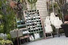 Hitched event favor display with a collection of pieces from Found Vintage Rentals
