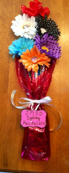 """""""Edible/wearable"""" bouquet I made for my daughters' dance recitals.  The """"flowers"""" made into hair bows and the """"stems"""" are Laffy Taffy Ropes and Gum balls"""