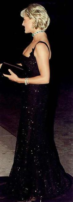 Diana wore this beautiful black gown on her 36th birthday, July 1, 1997......complete glamourous look put together...dress, jewelry, clutch , hairand of course the long, lean body. I love the look which I will never have