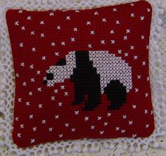 Cross Stitch panda in snow pincushion by GraceAndWhimsy on Etsy