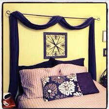 A curtain rod and long fabric draped over the headboard area makes a stunning wall decor piece yet costs under $20!