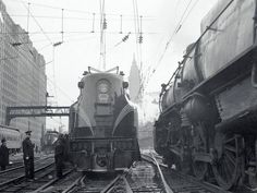GG-1 # 4859 leaving Philadelphia for it's maiden run westward to Harrisburg, Penna. January 15, 1938. GG-1 #4859 is still under roof under the Harrisburg station. #4859 was kept there because it was the first electric locomotive to travel on the newly-electrified Main Line from Philadelphia to Harrisburg on January 15, 1938.