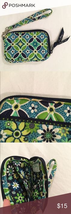 Vera Bradley Wristlet This wristlet is perfect to use as a cash or change purse and fits any credit cards, gift cards, ect perfectly!! 💗💗💗 Its been used quite a lot, but the only discoloration is on the strap & around the zippers- other than that, it is in perfect condition! 💓💓 Purchase 2 or more items and get 10% off!! 💓💓 Vera Bradley Bags Clutches & Wristlets