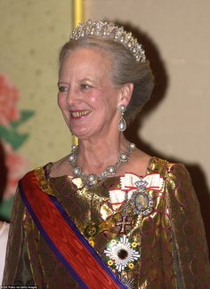 Queen Margrethe, pictured on a state visit to Japan in 2004, wears the Pearl Poiré Tiara, which comprises 18 pearl poirés (dropped pearls) framed by diamond-encrusted arches