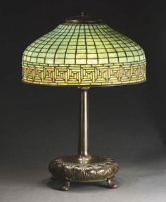 Tiffany Studios table lamp has leaded glass shade with a Greek key border surrounding the skirt set against a nicely .