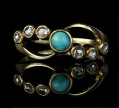 - Art Nouveau Turquoise and Diamond Ring  - c. 1890-1915  - 18k yellow gold, one 5 mm Persian turquoise, six .05 carat rose-cut diamonds for an approximate .3 carat total diamond weight  - Found in Buenos Aires, Argentina