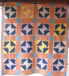 Primitive Antique Quilt - listed as Bear Claw, but looks like Delectable Mountains to us
