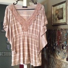 FINAL Price Drop! Size M Beige Top Unique flap sides appear ruffled.  trimmed with beige lace at neckline. Tops Blouses