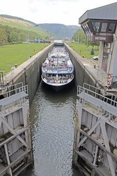 River cruise ship squeezing through the locks on the Moselle River