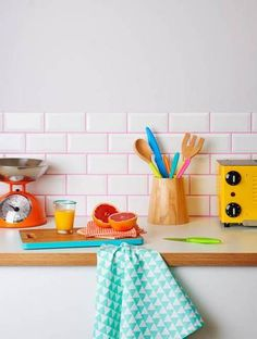 A white backsplash with neon pink grout!