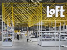 This loft is an exhibition Stand Design featuring coloured framework and modular display system. Exhibition Stand Design, Exhibition Display, Exhibition Space, Exhibition Ideas, Commercial Design, Commercial Interiors, Supermarket Design, Retail Interior, Store Design