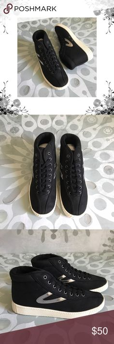 """Tretorn 'Nylitehi' Sneakers Manufacturer Color is Black/Silver. New with box. Heel Height is approx 1"""". Platform Height is 3/4"""". Lace-up closure. Material is Textile/Man Made. Canvas fabric with Faux Leather Trim. Bundle for discounts! Thank you for shopping my closet! Tretorn Shoes Sneakers"""