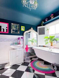The main bathroom in this fun family home with with claw foot bathtub and quirky neon pops of colour Quirky Bathroom, Eclectic Bathroom, Kid Bathroom Decor, Bathroom Colors, Bathroom Interior Design, Small Bathroom, Bathroom Tray, Quirky Home Decor, Neon Home Decor