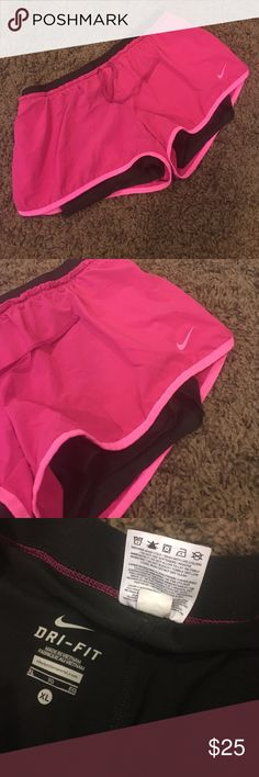 Nike Dri-Fit shorts with spandex lining Worn a handful of times, in new condition with no flaws. Size XL, but they definitely fit more like a large. Built in spandex lining. Nike Shorts