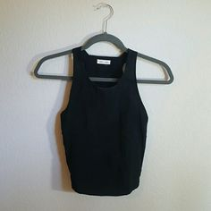 Silence + Noise Black Crop Top Great crop top for summer music festivals. Would go perfect with high rise jean shorts or maxi skirts! Top has an v shaped slit on both sides. Material is very breathable. Fits true to size. No holes or shrinking.  ❌Price is firm, no offers please  *Bundle 2 items or more for 10% off  *No trades Urban Outfitters Tops Crop Tops