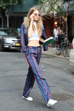 From Gigi Hadid in a striped Tommy Hilfiger suit in New York to Alicia Vikander in a Louis Vuitton dress in Los Angeles and Karlie Kloss in Dolce Style Gigi Hadid, Gigi Hadid Looks, Gigi Hadid Outfits, Fashion Mode, Look Fashion, Fashion Outfits, Costume Tommy Hilfiger, Vogue, Fashion Weeks
